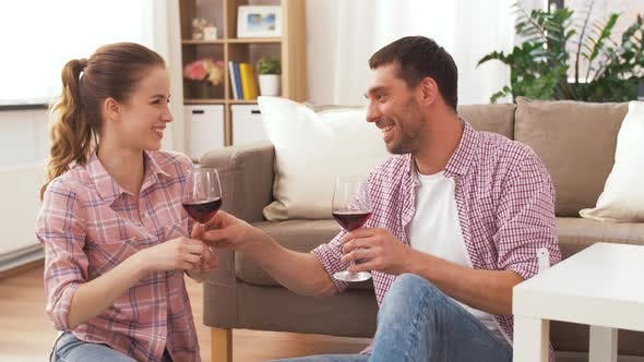 Cover Image for Happy Couple Drinking Red Wine at Home