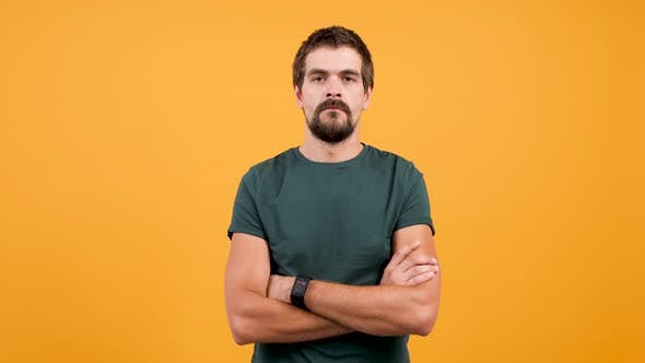 Handsome Man in Casual T-shirt Sweating From Hot Weather
