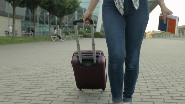 Woman Tourist Walking with Luggage From Airport. Girl Smiling, Rejoices. Vacation, Trip, Holidays