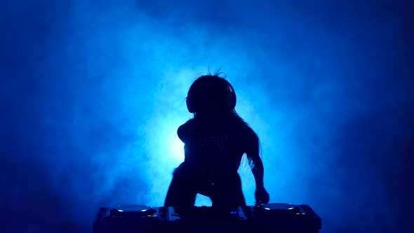 Thumbnail for Silhouette of Girl DJ in the Smoke Mixes Music