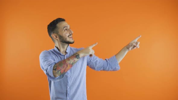 Cover Image for Young Casual Man Presenting Something with Both Hands and a Smile on His Face