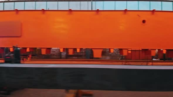 Thumbnail for A Piece of Lifting Orange Crane at the Plant