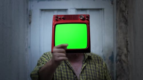 Retro TV with Green Screen on the Head of a Man.