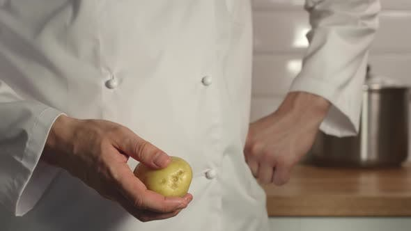 Cover Image for Chief Throws Up A Potato In A Hand
