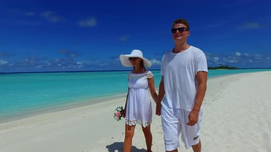 Fun people married on vacation enjoy life on beach on sunny white sandy background