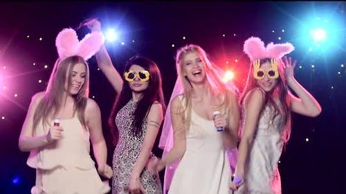 Four Girls Having Fun at Bachelorette Party Blowing Soap Bubbles