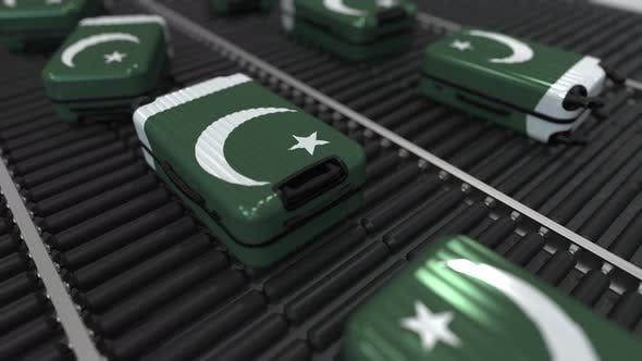 Thumbnail for Suitcases Featuring Flag of Pakistan on Roller Conveyer