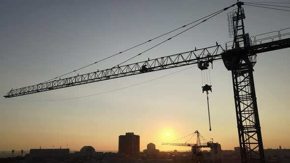 Thumbnail for Construction Crane on a Construction Site in the City at Sunrise. Kyiv, Ukraine. Aerial View