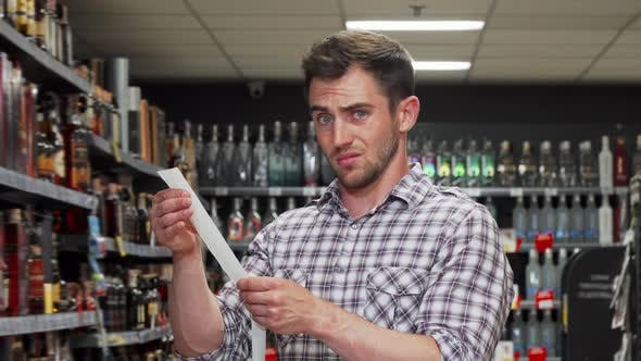 Thumbnail for Man Looks Devastated After Paying Shopping Bill at the Supermarket