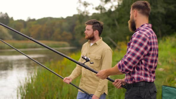 Happy Friends with Fishing Rods on Lake 43