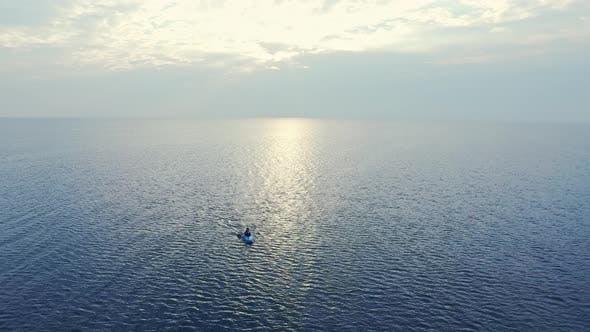 Thumbnail for Sportsman Swimming Kayak in Sea at Sunset