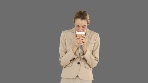 Thumbnail for Businesswoman Drinking Coffee To Go 2