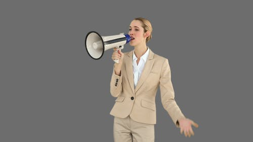 Positive Businesswoman Shouting In To Megaphone 2