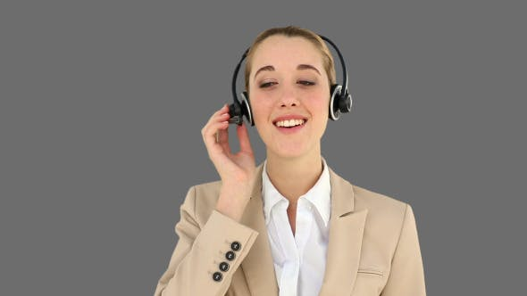 Smiling Call Centre Agent Talking On The Headset 2