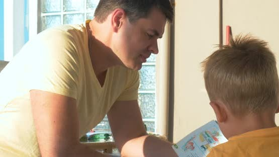Father Reading Book to His Son