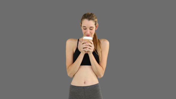Thumbnail for Fit Model Drinking From Disposable Cup 2