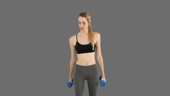 Thumbnail for Fit Model Lifting Dumbbells 2