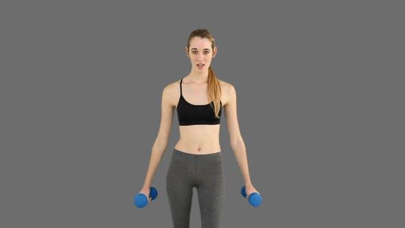 Thumbnail for Fit Model Raising Dumbbells 2