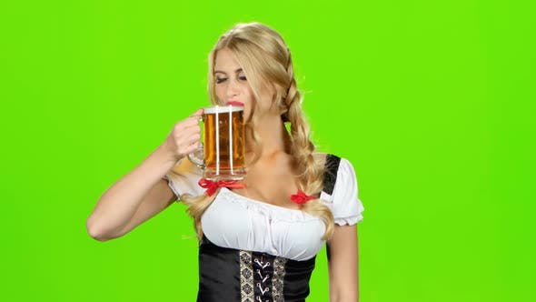 Thumbnail for Girl in Bavarian Costume Is Enjoying a Sip of Beer. Green Screen