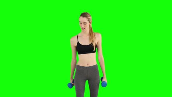 Thumbnail for Fit Model Lifting Dumbbells 1