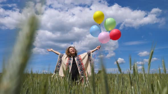 Thumbnail for Motivational Inspirational Video With Happy Woman In Field Holding Balloons
