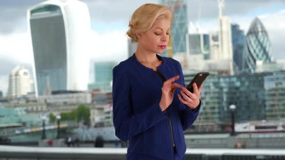 Thumbnail for London businesswoman typing message on mobile phone