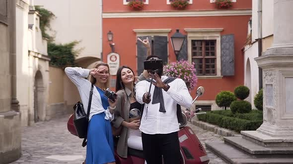 Thumbnail for Attractive Joyful Mixed Races Friends Making Selfie with Funny faces