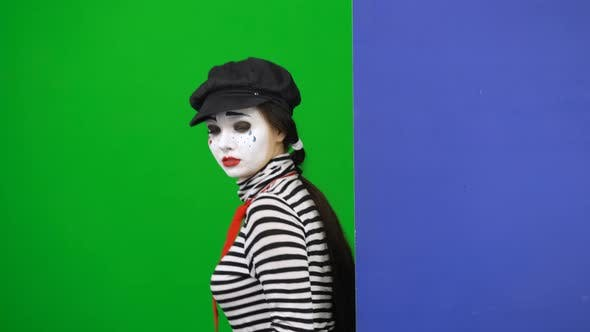 Thumbnail for Mime Peeking Out From Behind Board. Chroma Key. Close Up.