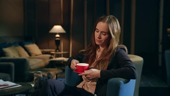 Thumbnail for Tired Businesswoman Drinking Tea in Hotel Lobby at Evening. Exhausted Woman