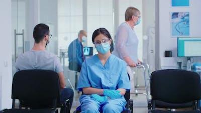 Worried Nurse with Face Mask Against Coronavirus