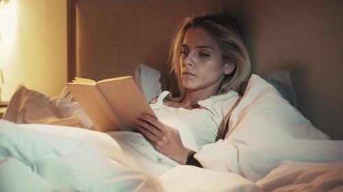 Bed Reading Night Fatigue Sleepy Woman with Book