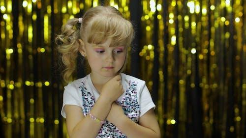 Shy Girl Is Ashamed. Looking Around. Little Cute Blonde Kid Teen Teenager Girl 4-5 Years Old