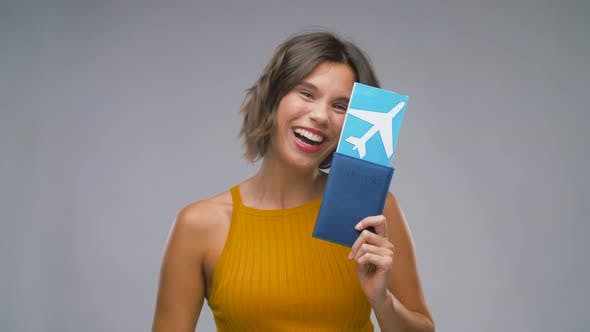 Happy Young Woman with Air Ticket and Passport