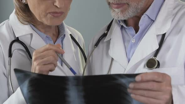 Cover Image for General Practitioner Consulting with Pulmonologist About X-Ray of Patients Lungs