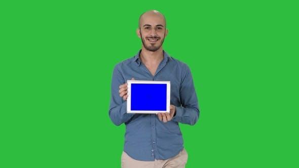 Thumbnail for Arab man walking and showing tablet presenting something