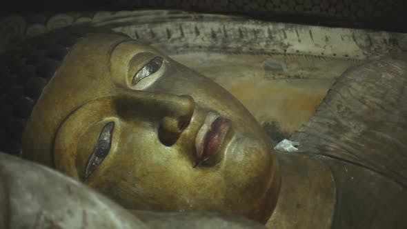 Thumbnail for DAMBULLA, SRI LANKA - FEBRUARY 2014: The view of a sleeping Buddha at the Golden Temple of Dambulla.