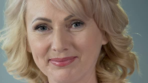 Thumbnail for Attractive Female Pensioner Smiling and Looking Into Camera, Anti-Age Makeup