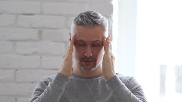 Cover Image for Headache, Frustrated Working Middle Aged Man in Office
