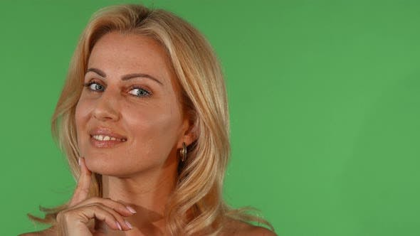 Thumbnail for Stunning Beautiful Mature Woman Smiling Looking Thoughtfully To the Camera