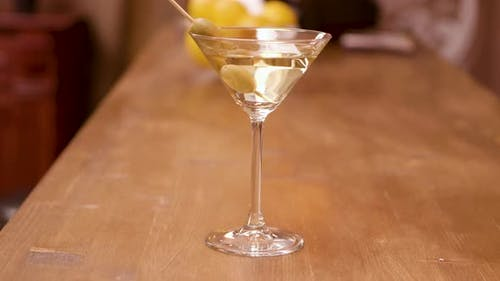 Parallax Shot of a Martini Glass on a Bar Counter