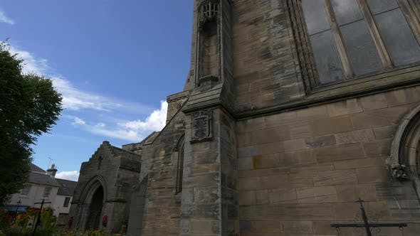 Thumbnail for The stone walls of a church