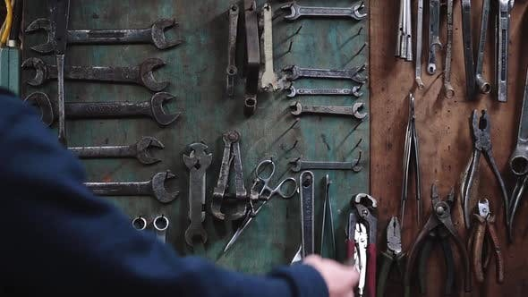 Stand with Wrenches at Workshop