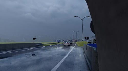 Vehicles Passing Through Tunnel in Rainy Weather