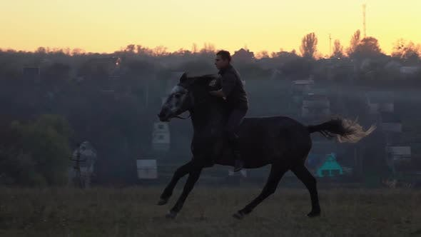 Guy at Sunset Jumping on a Stallion