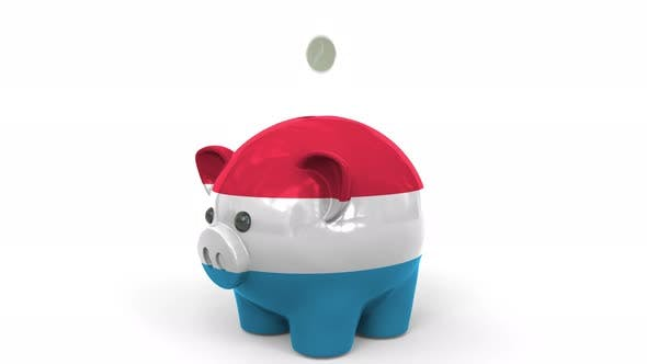 Thumbnail for Coins Fall Into Piggy Bank Painted with Flag of Luxembourg