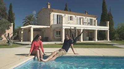 Couple on Pool Splashing With Water