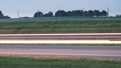 Light Trails of a Cars Driving Fast on a Highway or Motorway