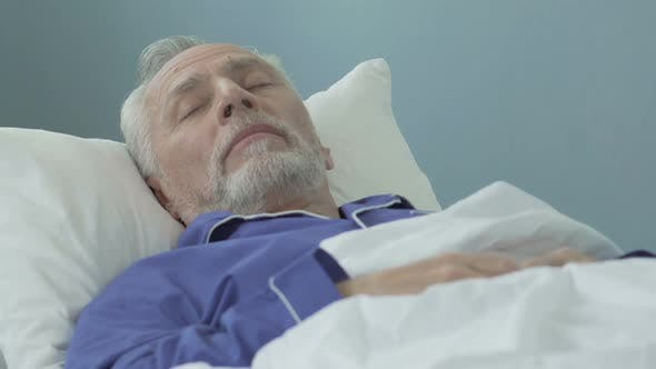 Thumbnail for Senior Man Lying in Bed and Sleeping Healthy Sound Sleep Time in Retirement