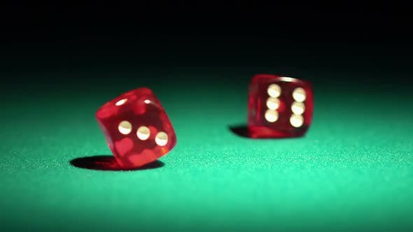Thumbnail for Red casino dice rolling on green table in slow motion, chances to win, gambling