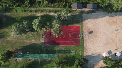 Aerial View of Basketball Court in a Nature Environment